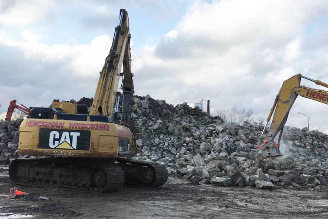 Construction equipment cleaning up sites